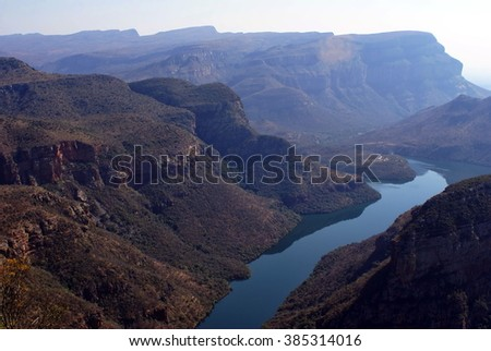 Blyde River Canyon in Mpumalanga, South Africa, with the Blyde River running through the center - stock photo