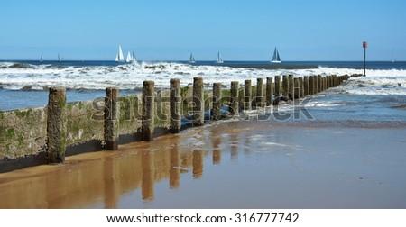 Blyth Beach, waves and pier. - stock photo