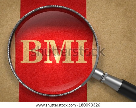 BMI concept. Magnifying Glass on Old Paper with Red Vertical Line Background. - stock photo