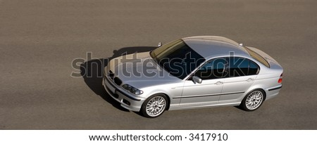 bmw 5 series german sedan speed isolated on gray asphalt front head view