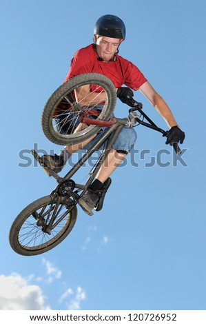 Bmx rider making a bike jump called table top - stock photo