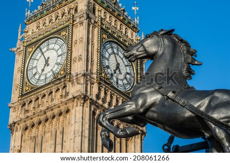 Boadicea statue's horse on Westminster Bridge and Big Ben in London - stock photo