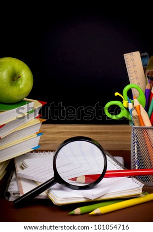 board,  books, pencils, opened empty notebook lie on school desk - stock photo