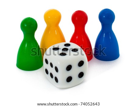 Board game figures and one dice - stock photo