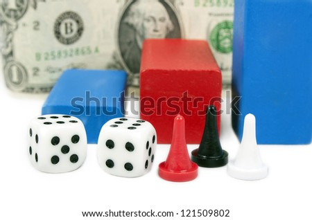 Board game figures and two dice against a banknote - stock photo