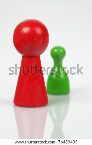 Board game pieces - symbol for leadership - stock photo