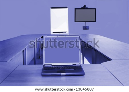 Board room in office block with laptop and video conferencing equipment - stock photo