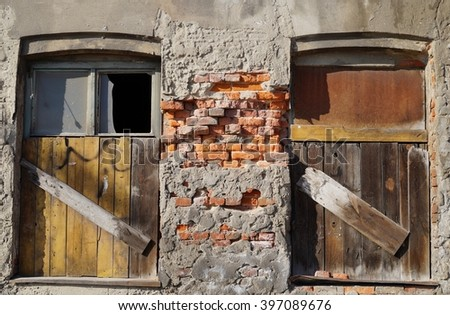 Boarded up windows on a brick building. - stock photo