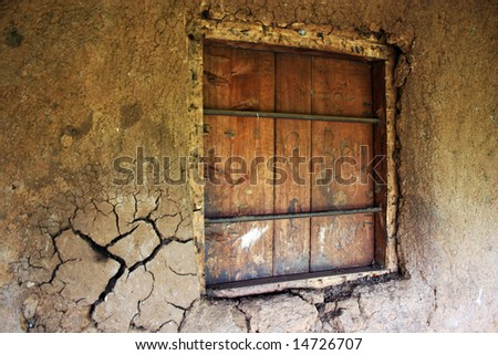 Boarded Window in Cracked Mud Wall (Background) - stock photo