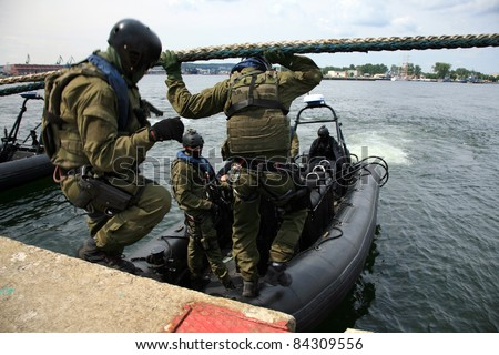 Boarding a ship – soldier. The Marine special forces to enter the ship to its search and hostage rescue – before training. - stock photo