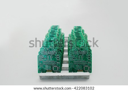 Boards are in a row. Factory for the production of chips. - stock photo