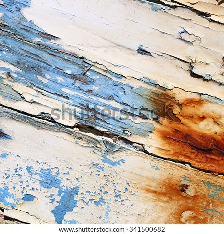 Boards of old boat with peeling paint background texture - stock photo