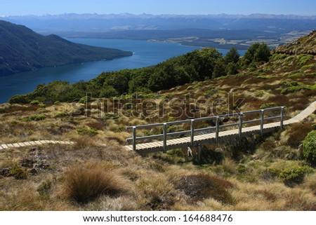boardwalk above lake Te Anau, New Zealand - stock photo