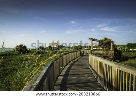 Boardwalk at Satellite Beach in Florida During a summer morning. - stock photo
