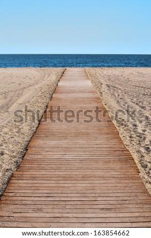 Boardwalk on the beach - stock photo