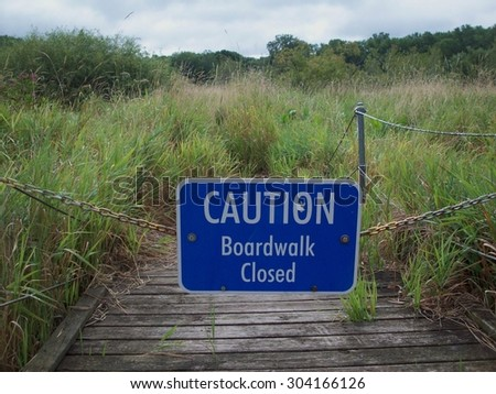 Boardwalk Through The Wetland - stock photo