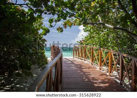 Boardwalk to a white sand beach in Varadero, Cuba. - stock photo