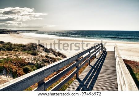 Boardwalk to beach - stock photo