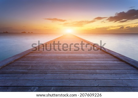 Boardwalk to the sea at sunset beach in Koh Samui, Thailand - stock photo
