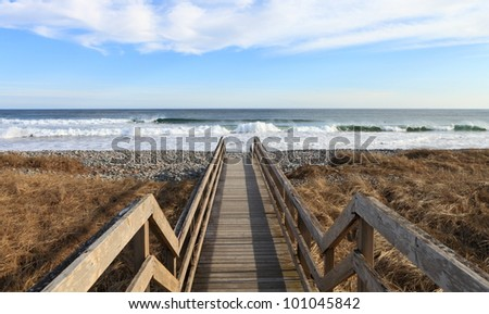 Boardwalk to the surf - stock photo