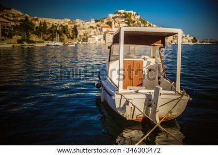 Boat about Sibenik. Sibenik is historic town in Croatia, located in central Dalmatia where river Krka flows into Adriatic Sea. Sibenik is political and tourist center of Sibenikâ??Knin County. - stock photo