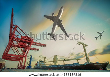 Boat and air plain for in background of Container Cargo freight ship with working crane loading bridge in shipyard at dusk for Logistic Import Export background - stock photo