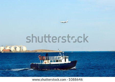 Boat and airplane. Boston Harbor. - stock photo