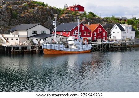 Boat and fisherman's village in Norway - stock photo