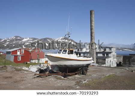 Boat and old fishing factory houses - stock photo