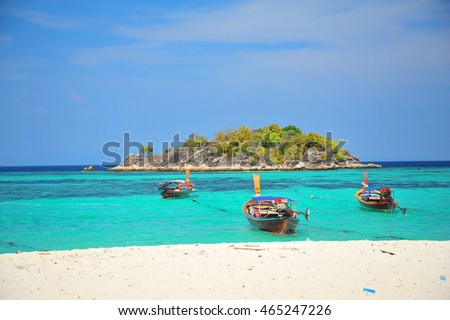 Boat and Paradise Island in Thailand