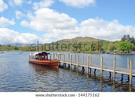 Boat at Jetty, Ambleside,  Lake Windermere - stock photo