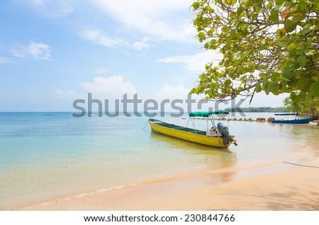 Boat at the beach of Boca del Drago, archipelago Bocas del Toro, Panama - stock photo