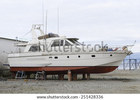 boat at the dock for repairs - stock photo