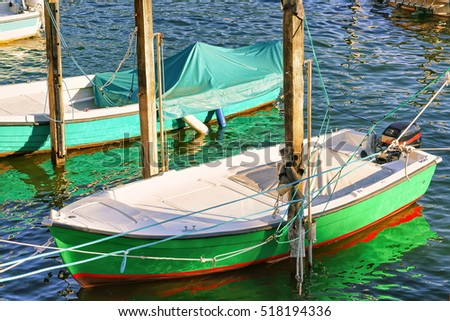 Boat at the embankment of Ascona luxurious resort on Lake Maggiore in Ticino canton in Switzerland.