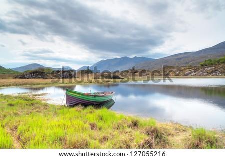 Boat at the Killarney lake in Co. Kerry, Ireland - stock photo