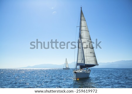 Boat competitor of sailing regatta in clear sunny weather. Luxury yachts. - stock photo