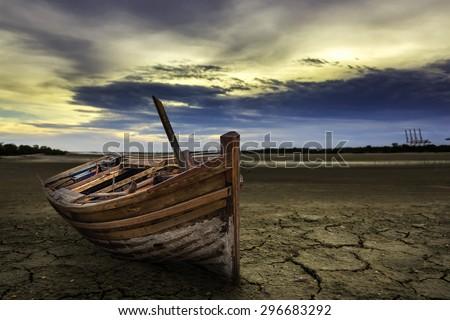 Boat crash landing land with dry and cracked ground. Desert - stock photo