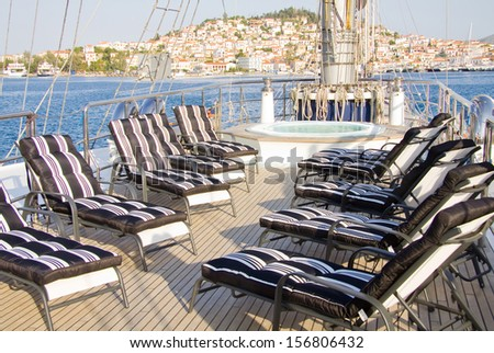 Boat deck with chair and jacuzzi beautiful sea view - stock photo