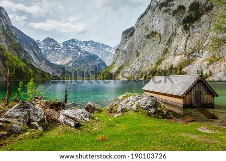 Boat dock hangar on Obersee mountain lake in Alps. Bavaria, Germany