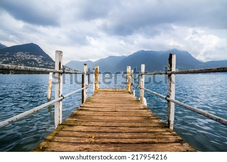 Boat dock in Lugano, Lake Lugano, Switzerland. European vacation, travel and nautical concept. - stock photo