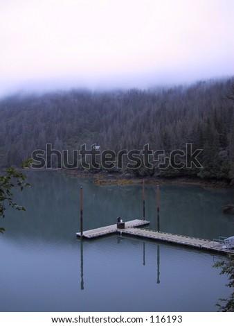Boat Dock on calm Halibut Cove Lagoon, Alaska - stock photo