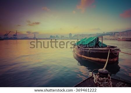Boat docked in harbor. - stock photo
