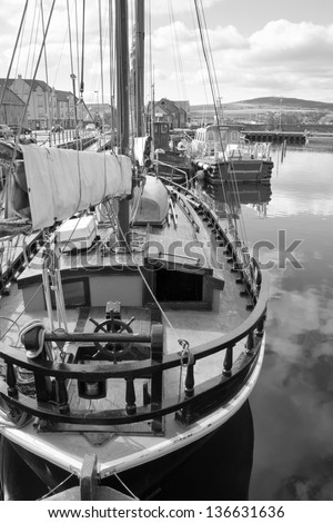 Boat docked in Kirkwall harbour - stock photo