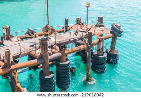 Boat docks in the turqouise sea - stock photo