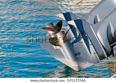 boat engine propellers over blue water