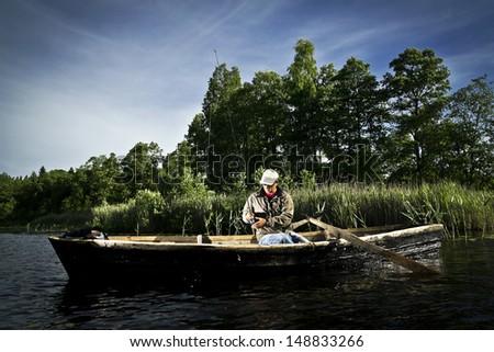 boat fishing - stock photo