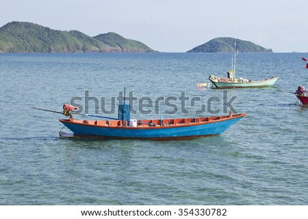 Boat fishing during the sun rises  - stock photo