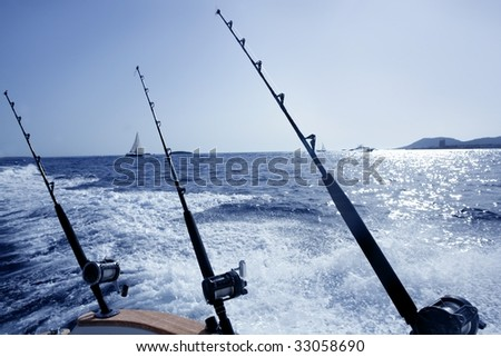 Boat fishing rods and reels in saltwater Mediterranean sea - stock photo