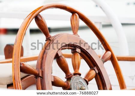 boat helm wheel - stock photo