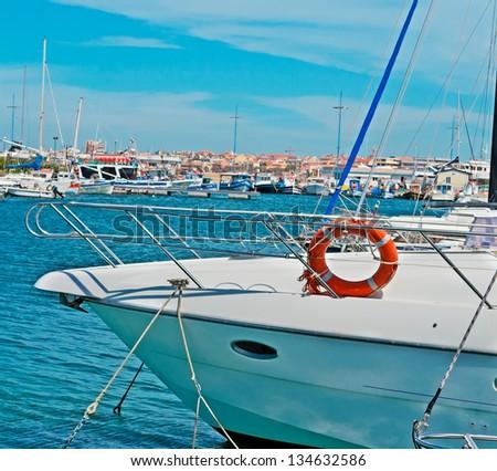 boat hull docked in Alghero harbor - stock photo